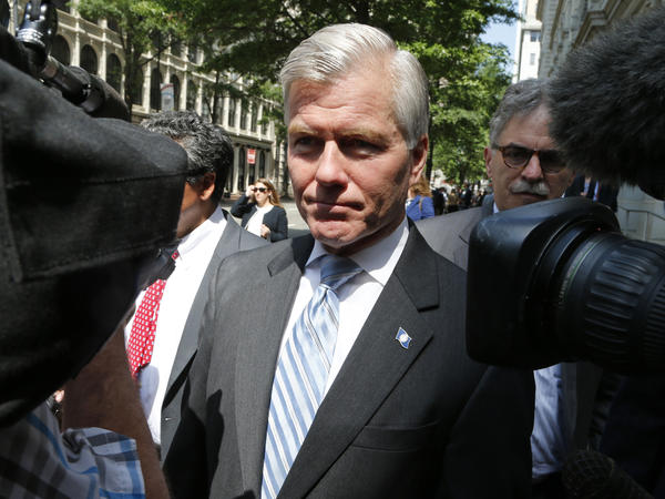 Former Virginia Gov. Bob McDonnell navigates a group of cameras as he leaves the 4th U.S. Circuit Court of Appeals in Richmond, Va., last May.