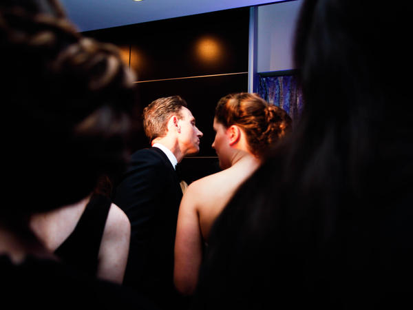 Actor Tony Goldwyn leans over the bar during a crowded party leading up to the White House Correspondents' Association Dinner on Saturday in Washington D.C.