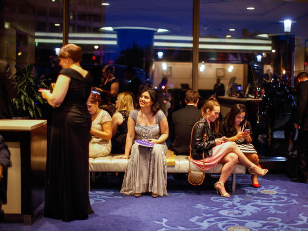 Fans and staff wait for a glimpse of celebrities exiting after in the lobby of the Washington Hilton on Saturday in Washington, D.C.