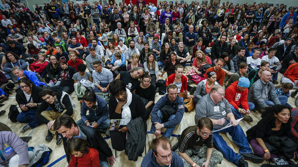 Colorado Democrats pack a gym at a Denver high school during caucuses on March 1, 2016. The crowds and long lines have led to calls for the state to move to an open primary system.
