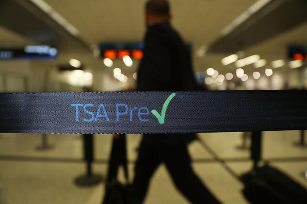 Travelers go through the TSA PreCheck security point at Miami International Airport on June 2. The number of TSA PreCheck applicants has more than doubled owing to record security wait times.