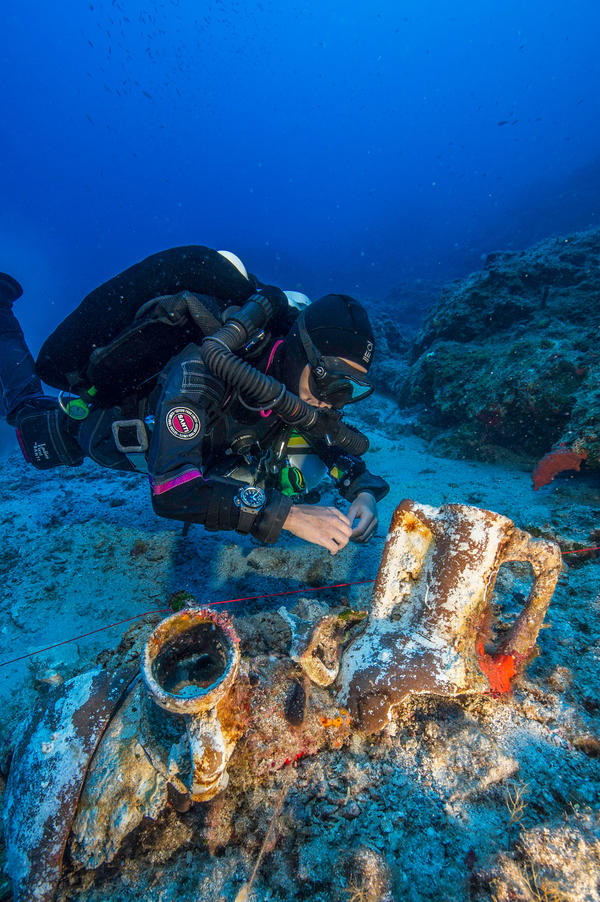 Professional technical diver Gemma Smith studies artifacts on the Antikythera shipwreck.