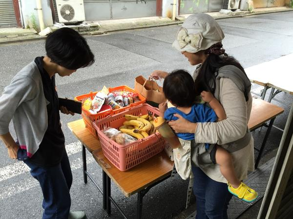 A Japanese mother and her 2-year-old pick up free groceries in Tokyo at the charity Second Harvest. Japan has a limited safety net for the poor and the economy is still struggling to gain traction under Prime Minister Shinzo Abe.