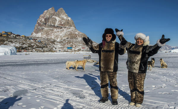 U.N. Secretary-General Ban Ki-moon (left) and Greenland's then-Prime Minister Aleqa Hammond stand on the ice outside the city of Uummannaq, north of the Arctic Circle, in 2014. Greenland held a referendum in 1982 and voted to leave the European Economic Community, the forerunner of the European Union. Greenland's leaders say they believe it was the right decision.