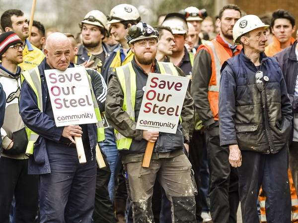 Workers gather at the Tata Steel plant in Port Talbot, Wales, on April 1. The company had put its British business, including the plant, up for sale. Once Brexit was approved, Tata announced it was putting the sale on hold.