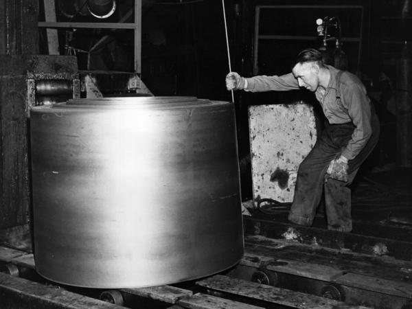 An employee of the Abbey Steelworks, a predecessor to the current plant in Port Talbot, measures a roll of steel in 1961. The plant's current workforce of 4,000 workers is about a fifth of what it was in its heyday.