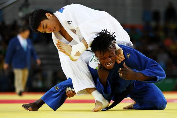 Donghan Gwak of Korea (left) competes against Popole Misenga of the Refugee Olympic Team during a men's 90kg bout on Wednesday in Rio.