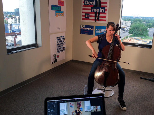 Laura Cooke, an organizer with the Clinton campaign in Colorado Springs, has played the cello live on Facebook, a tool the Clinton campaign uses to encourage millennials to register to vote.