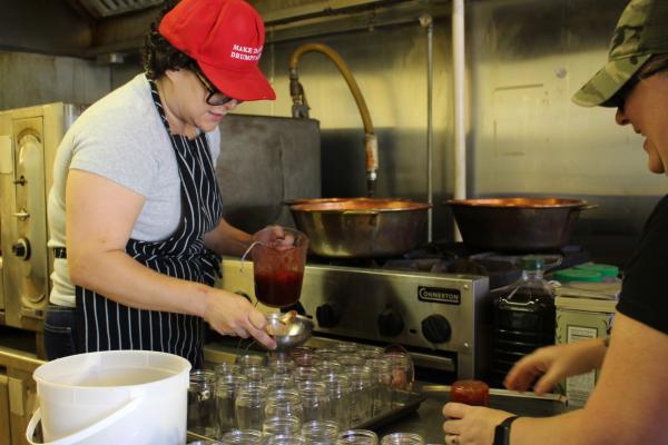 Kathey Lee, owner of jam company Modern Gingham, fills jars at her shared kitchen in Denver.