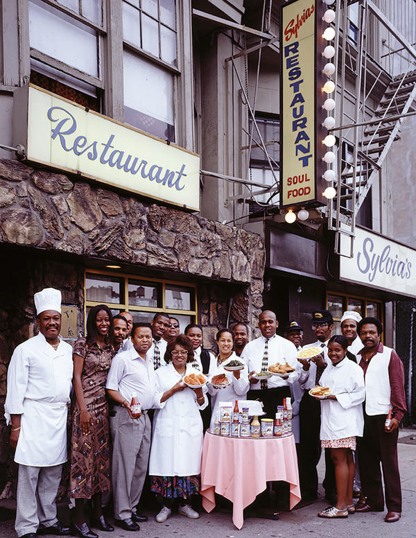 Sylvia Woods and her employees outside Sylvia's restaurant, a legendary soul-food restaurant in Harlem.