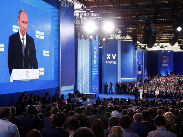 Russian President Vladimir Putin addresses the audience at the United Russia party congress held in Moscow in June, three months ahead of parliamentary elections this Sunday. His party is expected to retain its majority.