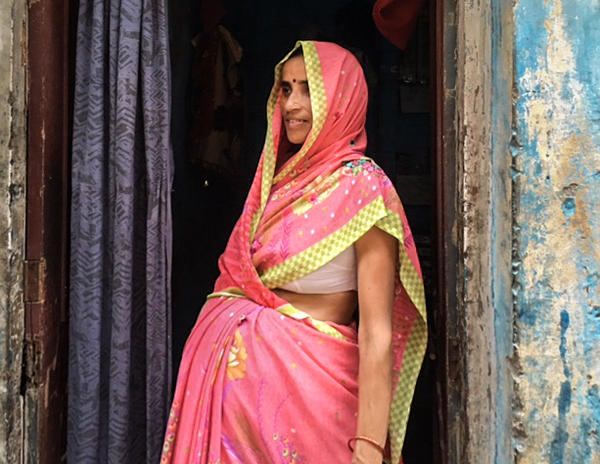 Isha Devi, 30, became a surrogate to help keep her family afloat. Her husband, a rickshaw driver, couldn't work after an accident with a bus — and medical bills began mounting up.