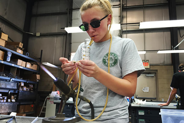 Leah Prevost, 21, works on a glass coil condenser at Salem Community College's Glass Education Center in Alloway, NJ.