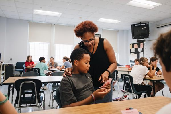 Bryan Bailey in math class with his teacher, Kirsten Turner.