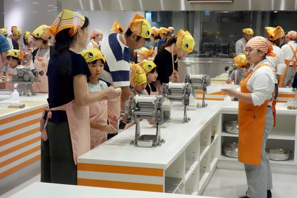 Visitors make their own noodles in the museum's working kitchen.