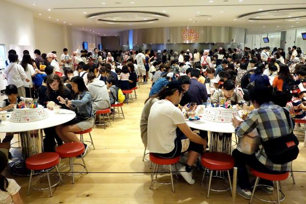 Crowds fill the Cup Noodles Museum in Yokohama, Japan, to decorate their own branded cups before creating personal noodle flavor blends.