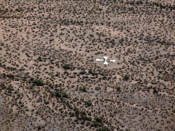 """Pez Owen was joyriding in her Cessna airplane when she first spotted a giant X etched in the desert. """"It's not on the [flight] chart. There just wasn't any indication of this huge cross,"""" she says."""