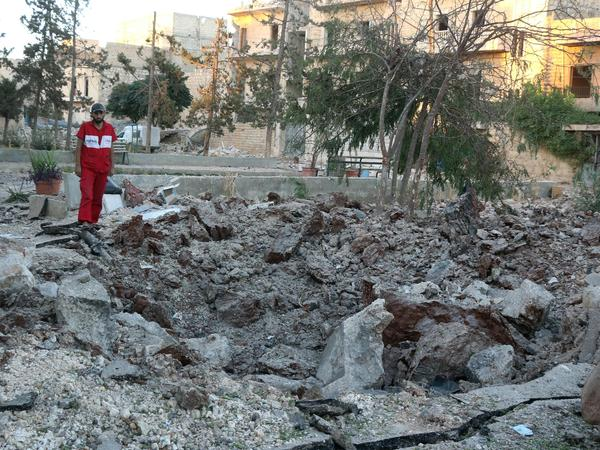 A Syrian medical worker inspects the damage at the site of a medical facility after it was reportedly hit by Syrian regime barrel bombs on Oct. 1 in Aleppo's rebel-held neighborhood of al-Sakhour. Fewer than 30 doctors remain in the besieged city.
