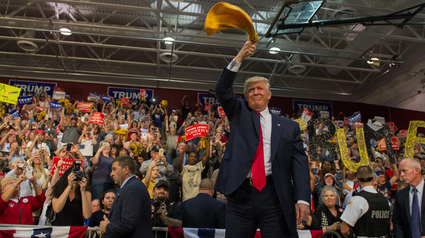 """Republican candidate for President Donald Trump waves a """"Terrible Towel"""" — an icon of the Pittsburgh Steelers — to supporters in Ambridge, Pa., on Monday"""