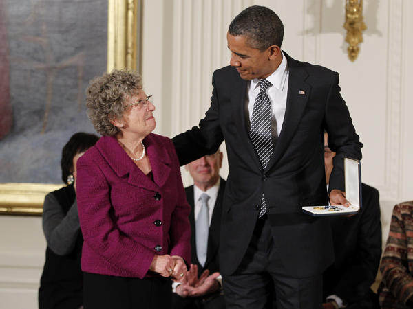 President Obama awards the 2011 Presidential Citizens Medal to Judith Broder during a ceremony at the White House. Broder created The Soldiers Project which meets mental needs of servicemembers and their families.