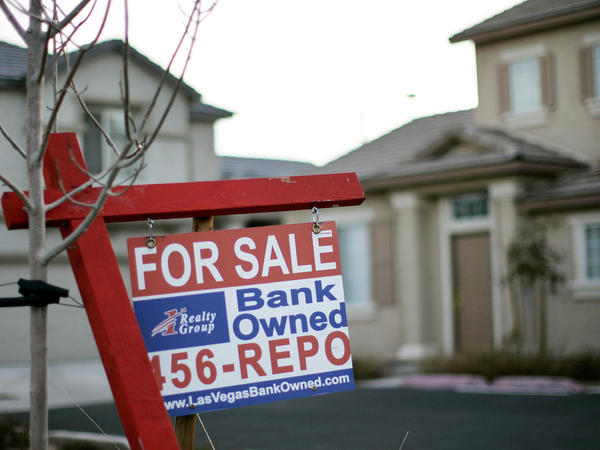 A for sale sign stands in front of a bank-owned home in Las Vegas in 2008.