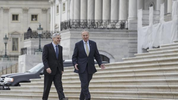 Supreme Court nominee Merrick Garland, left, walks with Sen. Chuck Schumer, D-N.Y., in March at the Capitol in Washington. Schumer is expected to become the new Senate minority leader, but with Donald Trump's election as president, Garland's nomination is done.