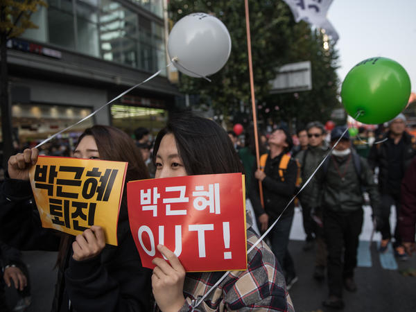 Anti-government protesters hold placards calling for the resignation of South Korean President Park Geun-Hye as they march towards the Gwanghwamun area of central Seoul on Saturday.