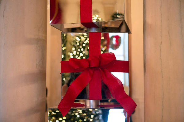 Mirrored presents are stacked in between columns in the Grand Foyer.
