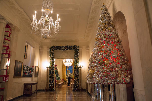"The Grand Foyer is decorated with shiny presents and mirrored ornaments to fit its theme of hope and gratitude, ""The Gift of Reflection."""