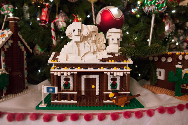 South Dakota's gingerbread house features Mount Rushmore and is one of the 56 one-of-a-kind Lego gingerbread houses--one for each state and territory. It took more than 200,000 Legos and 500 hours to build these decorations for the State Dining Room.