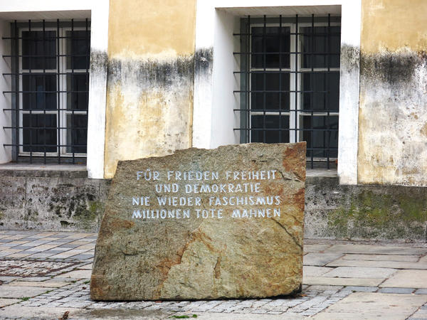 "This jagged stone in front of Adolf Hitler's birth house in Branau am Inn comes from the former Mauthausen concentration camp, a 90-minute drive away. The inscription reads: ""For peace, freedom and democracy. Never again fascism. Millions dead are a warning."""