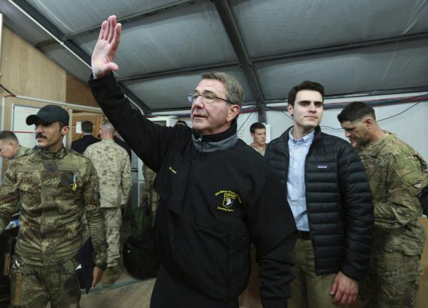 Defense Secretary Ash Carter waves to a group of Iraqi and U.S. soldiers during his visit to the Qayyarah Airfield West, south of Mosul, on Dec. 11.