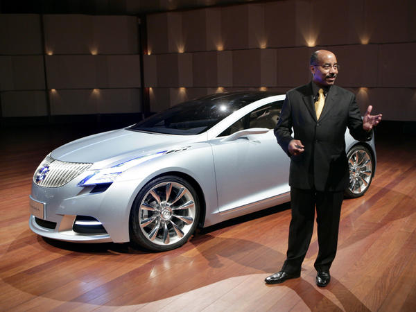 Ed Welburn, vice president of General Motors Global Design, stands with the Buick Riviera concept as it makes its North American debut at the North American International Auto Show in 2008 in Detroit.