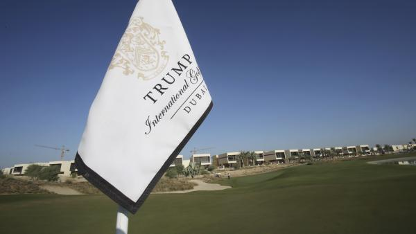 A flag flies on a green lined with villas at the Trump International Golf Club, Dubai in the United Arab Emirates on Dec. 20, 2016. The course is scheduled to open in February.