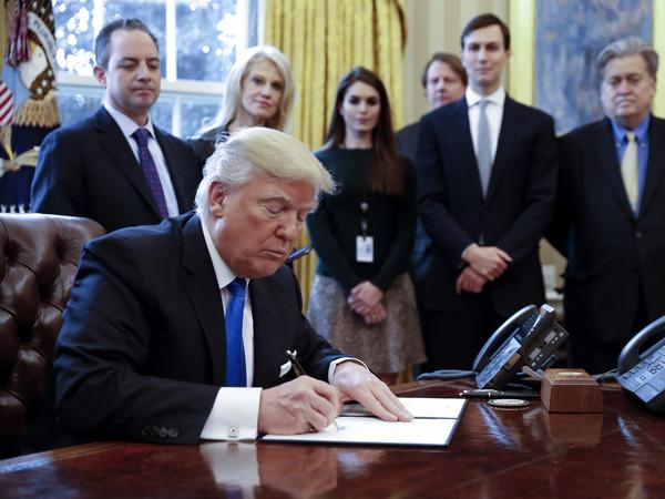 President Trump signs one of five executive orders related to the oil pipeline industry. Trump has been busy for more than two weeks rolling back President Barack Obama's environmental legacy.