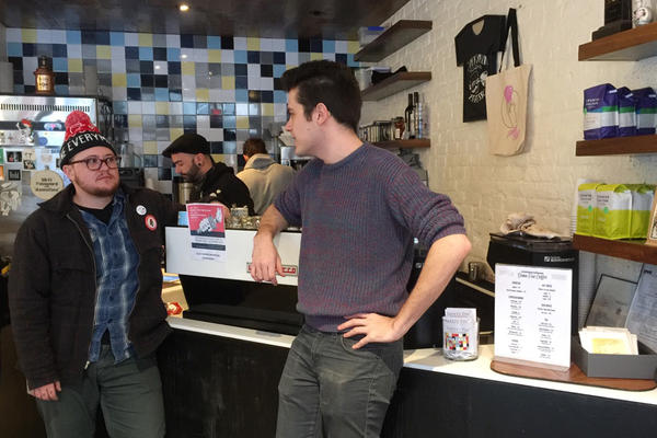 Owner Sam Penix (left) talks with manager Eric Grimm at the Everyday Espresso cafe.