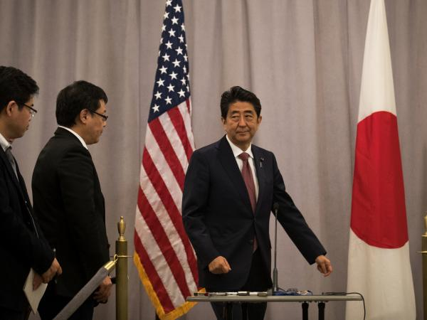 Prime Minister of Japan Shinzo Abe arrives to speak to reporters following a meeting with Donald Trump in November.
