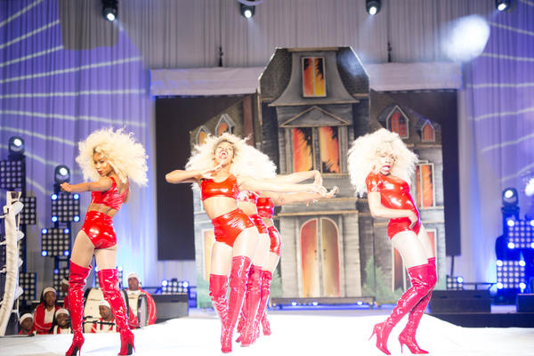 Models perform in custom-made blonde wigs at the 2016 Hair Battle. Each wig can take hours to design and create. Costumes, make-up and staging often take months to prepare.
