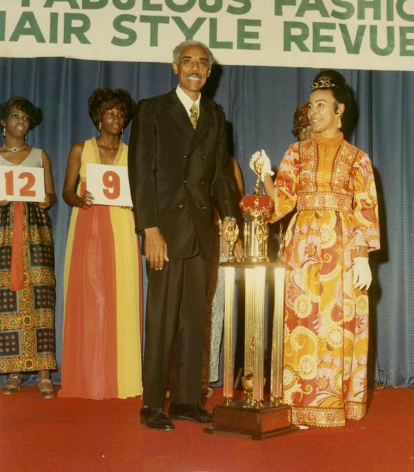 Dr. Nathaniel Bronner presenting the 1st place trophy to Xernona Clayton in the 1960s. She was a popular beautician before becoming a renowned civil rights leader and broadcasting executive.
