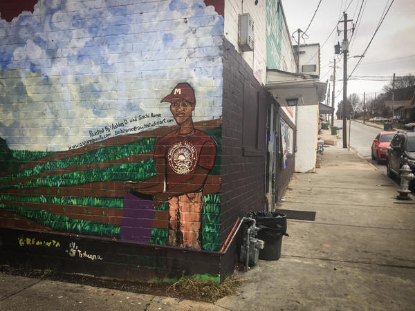 Kids in the Ashview Heights community painted a mural on the side of the Fair Street Superette, the corner store near the site for Marddy's shared kitchen and marketplace.