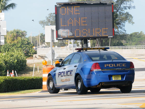 A Palm Beach Police car sits in front of a gate of the Mar-a-Lago Resort in November. During President Trump's frequent visits, the Secret Service shuts down a major thoroughfare, making it difficult to get anywhere in Palm Beach.