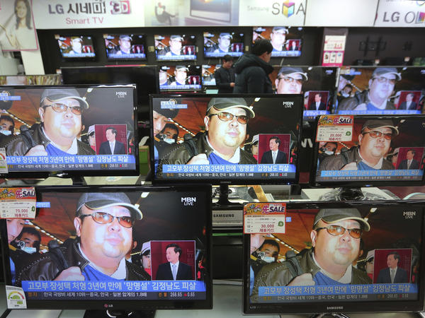 TV screens in Seoul, South Korea, show images Wednesday of Kim Jong Nam, the half-brother of North Korean leader Kim Jong Un.
