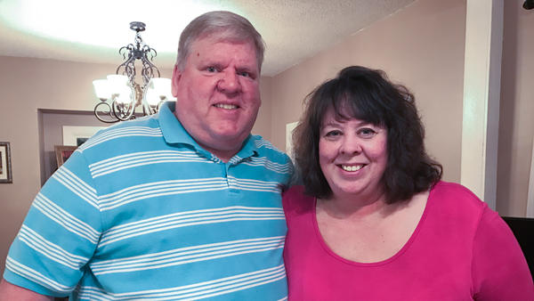 Brian and Jennifer Barfield met while searching for work. They voted for President Trump, though don't entirely agree on how well his first month in office has gone.
