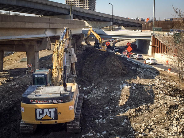 There are hints that the Trump administration might require all federally-funded construction projects to be done not only with steel and concrete made in the U.S. but also with American-made equipment, like this Caterpillar backhoe.