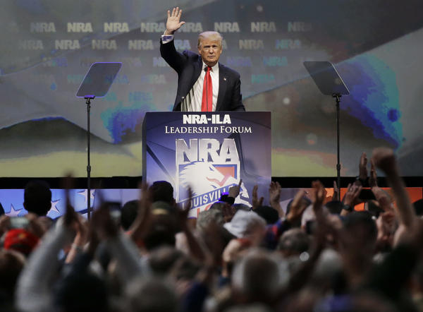 Then-Republican presidential candidate Donald Trump waves to the crowd after speaking at the National Rifle Association convention in May 2016. The NRA supports the repeal of the Obama-era rule.