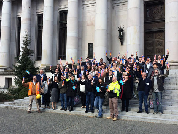 Members of the Building Industry Association of Washington gathered in front of the Washington Supreme Court before distributing water bottles to lawmakers and their staff.