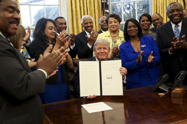 President Donald Trump signed an executive order pertaining to historically black colleges and universities in the Oval Office.