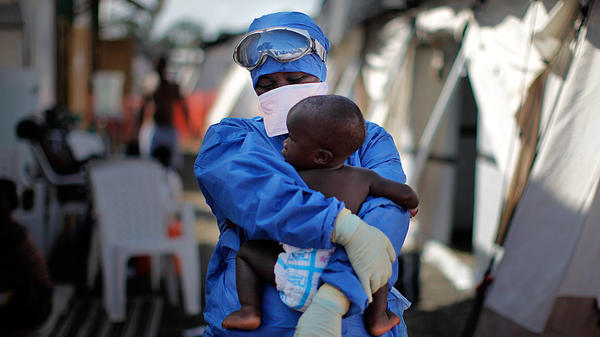 Salome Karwah holds a 10-month-old baby whose parents were treated for Ebola in the Doctors Without Borders center in Monrovia, Liberia. The photo was taken in 2014.