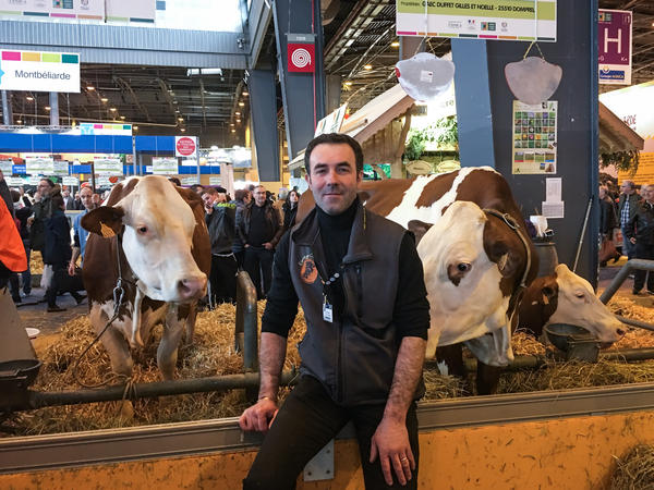 Thierry Chabot's Montbeliard cows wear giant bells around their necks. Chabot makes Comté cheese in the mountains near the Swiss border. He doesn't like presidential front-runner Marine Le Pen's ideas about leaving the European Union.