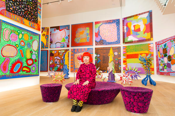 "Yayoi Kusama with recent works in Tokyo in 2016. In 1968, Kusama wrote, ""Our Earth is only one polka dot among a million stars in the cosmos. Polka dots are a way to infinity."""